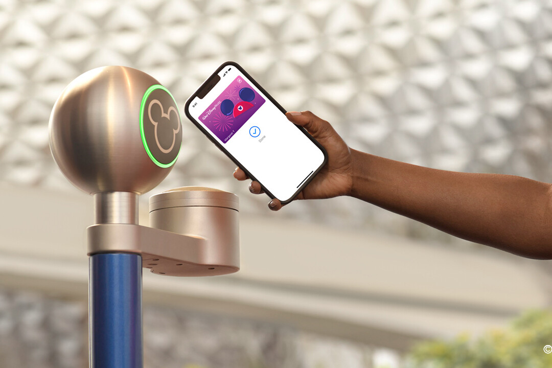 iPhone tapping Epcot turnstile - MagicMobile system at Disney World