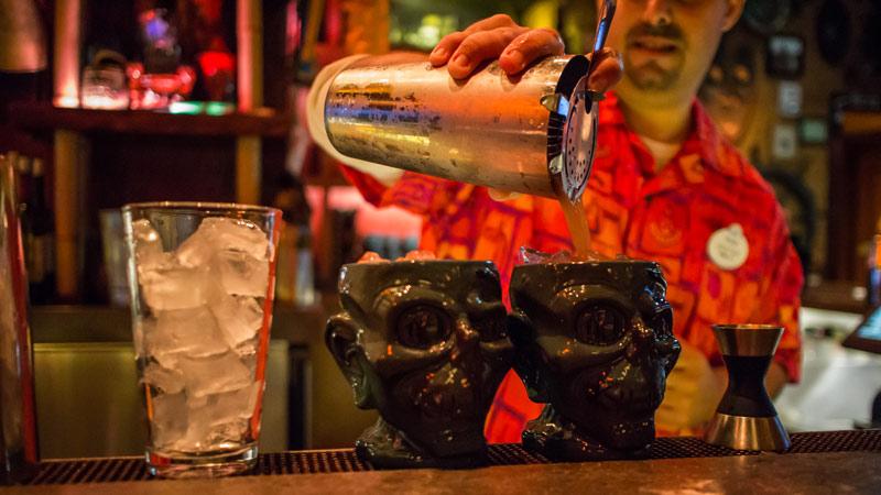 Bartender pouring Shrunken Zombie Heads - Trader Sam's