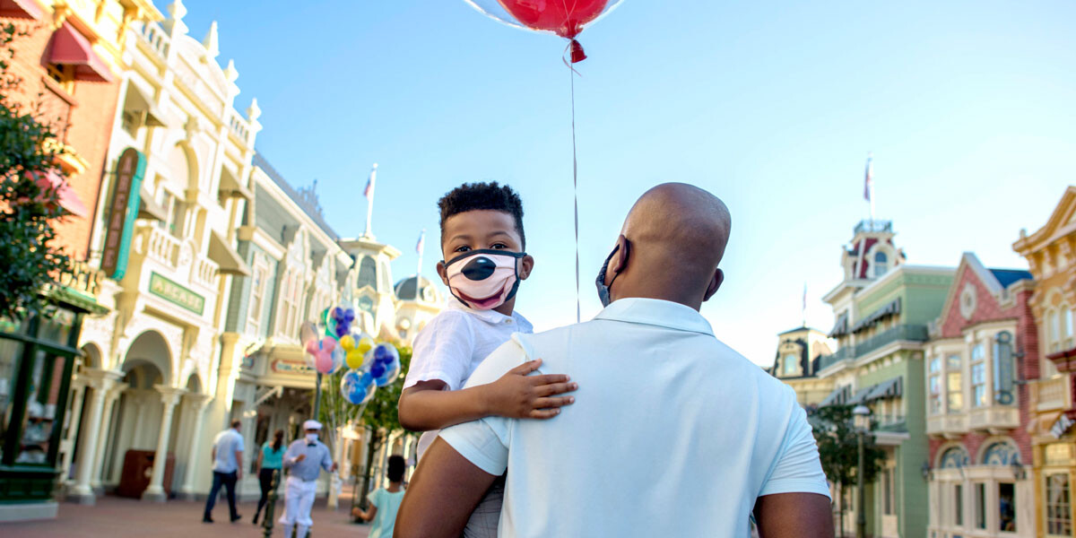 Disneyland Mask Rules - Father and Son walk down Main Street while wearing masks at Disneyland