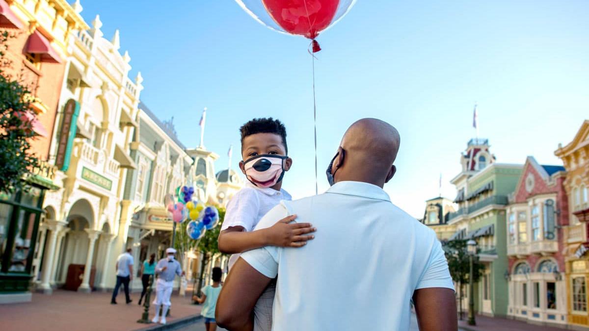 Disneyland Mask Rules - Father and Son walk down Main Street while wearing masks at Disneyland