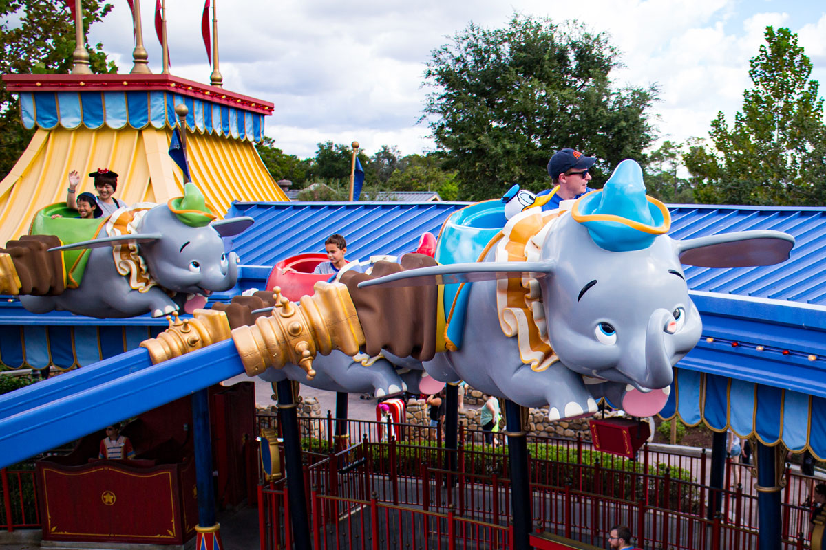Kids Riding Dumbo - Guide2WDW's Disney World Guide to saving money with kids