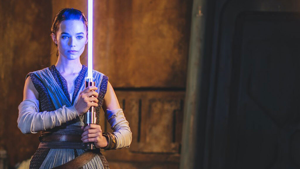Rey with a blue lightsaber at Disney World